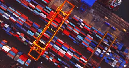 nakládané : VLADIVOSTOK, RUSSIA-DECEMBER 2, 2017: Top aerial view of many colorful containers in Vladivostok Commercial port, cranes and a coalship waiting for loading Dostupné videozáznamy