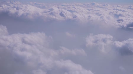 aircraft cabin : Flying in the sky and the sea of clouds. Airplane porthole with a spectacular view. Tourist stock video