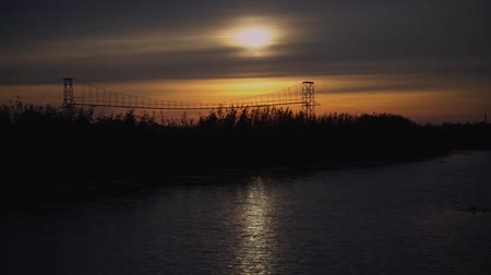 Beautiful sunset on the wild river. Landscape with red sun and blackout. Stock video