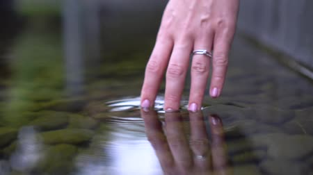 Woman holds water Transparent clear creek. Video background calm themes