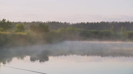 It is a mist over water. fishing in Siberia. Stock video Vídeos