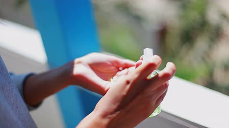 dezenfektan : girl carries out hand disinfection using an antiseptic vial hd