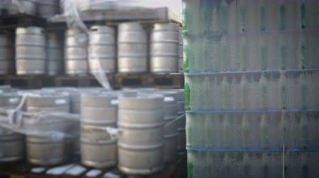 hops : Packed bottles of beer and barrels and at the beer factory