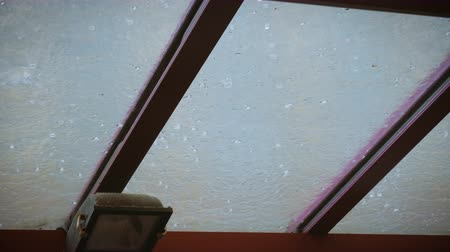 hail : Extreme weather hail hits the glass roof Stock Footage