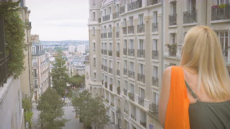 A woman watches Paris from a viewing platform on the Montmartre close shot