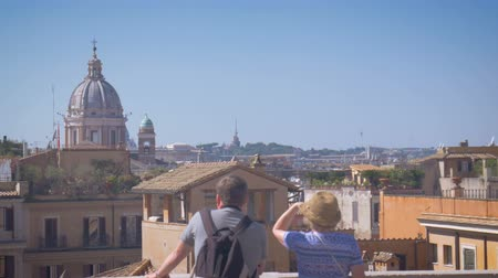 a couple of tourists watching from the height, Rome on a sunny day