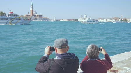 memories photos : Couple shoots Canale Grande in Venice Italy on a sunny day