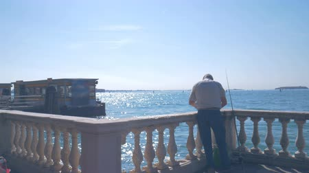 Fisherman on the promenade in Venice near Vaporetto stop