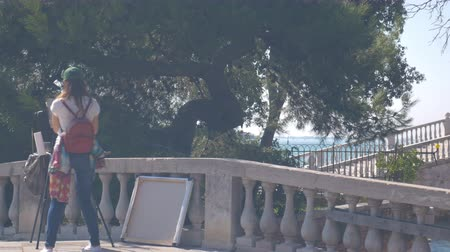 The artist photographing her painting in Venice