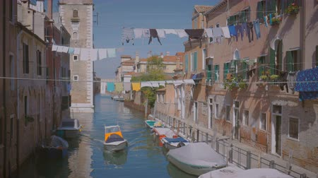 белье : Boat floating in the Canal in Venice drying underwear on the rope Italy sunny day