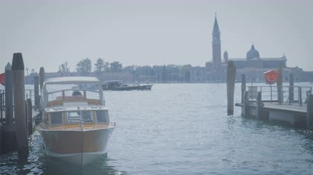 The boat moored to the quay on the canal in Venice