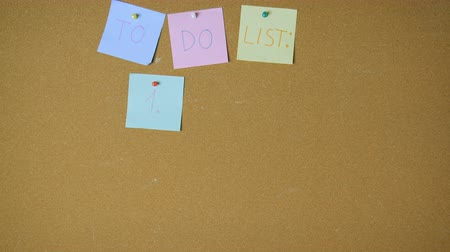 fazla : Hard working to do list. Hands pining sticky notes on pin board funny animation