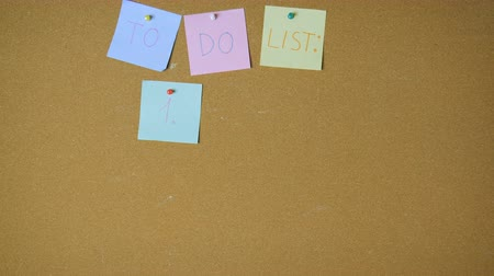 объявлять : To do list for tired people. Just sleep. Hands pining sticky notes on pin board funny animation Стоковые видеозаписи