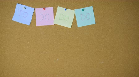 segnalibri : Do do list. Hands pining sticky notes on pin board funny animation Filmati Stock