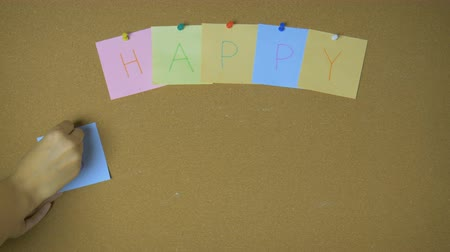 hand sign : Happy Birthday. Hands pining sticky notes on pin board funny animation Stock Footage