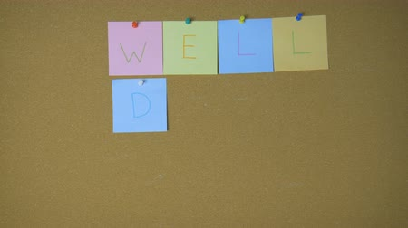 rajzszeg : Well Done. Hands pining sticky notes on pin board funny animation