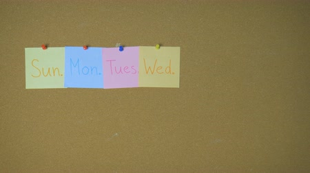 sobota : Days of week. Hands pining sticky notes on pin board funny animation
