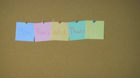 szervez : Days of week. Hands pining sticky notes on pin board funny animation
