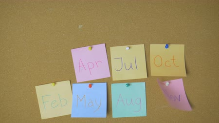 rajzszeg : Calendar. Hands pining and taking off sticky windy notes on pin board funny animation