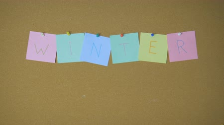 объявлять : Winter. Hands pining and taking off sticky windy notes on pin board funny animation