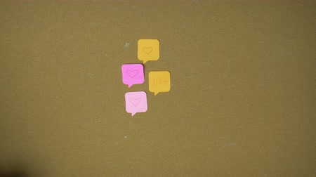 follower : Like Hands pining sticky notes on pin board funny animation Stock Footage