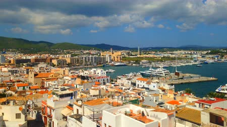 baleár : Cinemagraph - Clouds floating over the port of the Town of Ibiza on Ibiza Island.