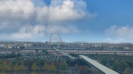 piemonte : Cinemagraph - Clouds floating over the industrial urban landscape on autumn day. Lingotto pedestrian bridge, Turin, Italy. Il ponte pedonale del Lingotto, Torino