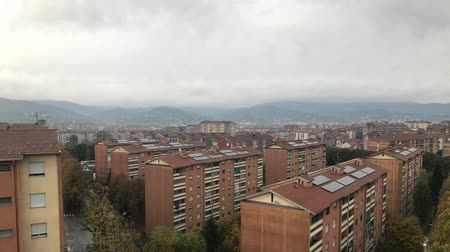 piemonte : Cinemagraph - Turin, Piedmont, Italy. Gray clouds floating over the housing area on the background of mountains. Barriera di Torino