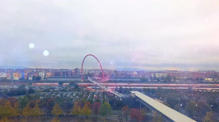 cinemagraph : Cinemagraph - Magic glowing over the industrial urban landscape on autumn day. Lingotto pedestrian bridge, Turin, Italy. Il ponte pedonale del Lingotto, Torino Stock Footage