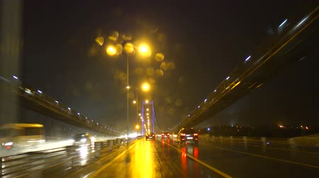 turecko : Driving on the Bosphorus Bridge on a rainy night in Istanbul Turkey. Camera is secured on the windshield of the car.