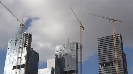projects : A timelapse movie of a construction project in a big city while the clouds moving behind.