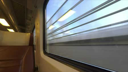 modern train wagon : Window view from fast train travelling in the Netherlands