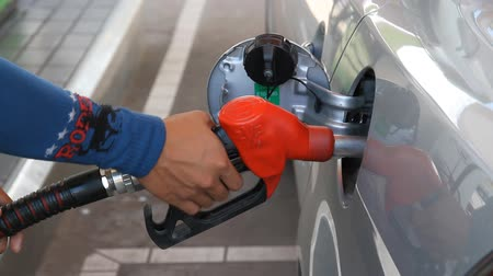 petrol : Refueling vehicles in petrol station to the car.