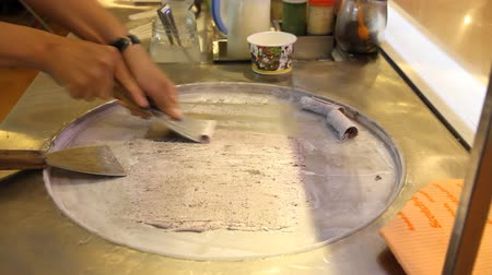 delicious : Chefs are making ice cream on a fry pan ice.