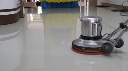 Scrubber is scrubbing the floor. Stock Footage