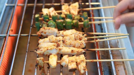 Sichuan pepper barbecue on grill grate at market street food.