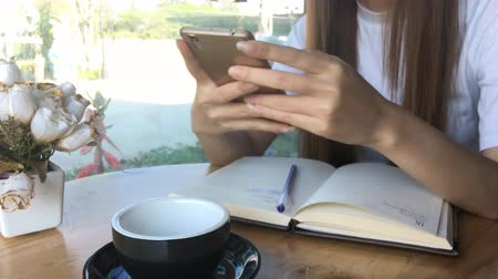 Asia girl use smartphone emotion happy and smile in cafe. Stock Footage