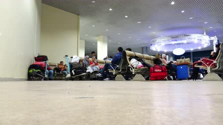 indian roller : Passengers sitting in the waiting room before the next flight of the aircraft