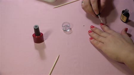 pinky : Manicure specialist put a layer of transparent nail polish on the nails treated Stock Footage