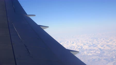 virginity : View from a plane window at the back of the wing and the ground. Sound. 4K