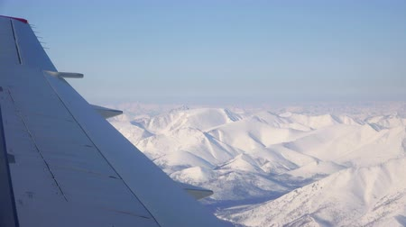 virginity : Low flying over mountainous terrain covered with permanent snow cover Stock Footage