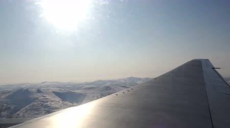 virginity : Piloting an airplane in the sky over the mountains in the winter sunshine