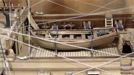 stylization : miniature replica naval ship consisting of wood and thread with the boat on deck and guns on board Stock Footage