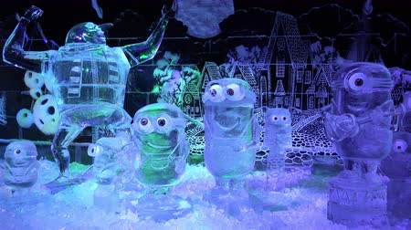 senhor : Russia, Saint-Petersburg, December 27, 2015 Sculptures Mr. Perkins and the Minions from the animated movie made out of ice Stock Footage