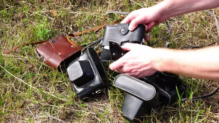 farag : RUSSIA, city Lipin Bor, July 8, 2016: demonstration of four vintage camera brand Zenith on the green grass Stock mozgókép