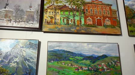 farag : RUSSIA, city Lipin Bor, July 8, 2016: Paintings by local artists painted oil hang on the wall of the exhibition hall Stock mozgókép