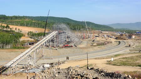 yapıcı : Overview panorama of the construction site of a large factory in the mountain range