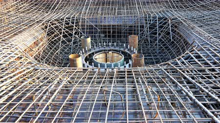 converge : bars of reinforcing mesh for foundation with pipes and embedded bolts