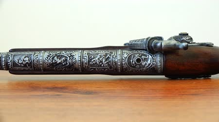 collectible : a musket with mahogany and engraving on the trunk