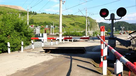 barrier gate : lifting of the barrier at the railway crossing